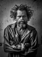 black and white photo of a homeless man with curly hair