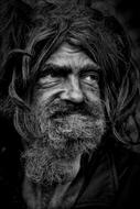 portrait of Homeless mature man with long hair