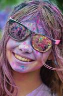 laughing Girl with painted face, happy holi festival