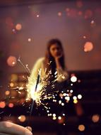 photo of sparklers and a girl on the couch