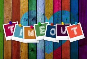 Timeout, colorful cards with letters on painted wooden planks