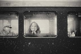 black and white photo of children in a train carriage