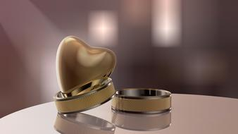 two wedding rings and a heart