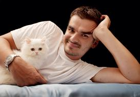 man with white fluffy cat