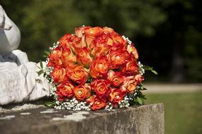 wedding bouquet lies on a monument