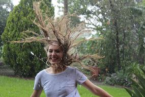 Happy young girl runs in Rain