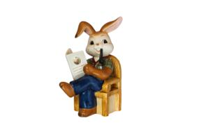 ceramic hare on a chair