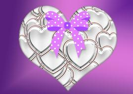 painted metal heart with polka dot bow