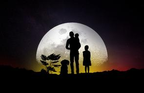 family silhouette of the moon background