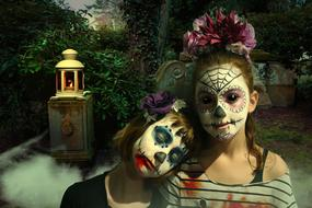 two child girls with sugar skull makeup