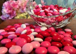Valentines, pink and red Candies on table