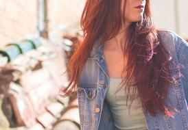 photo of a girl with long hair in a denim jacket