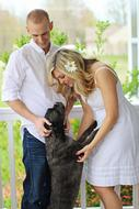 photo of happy family and beloved dog