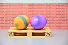 two Colored Easter Eggs on pallet