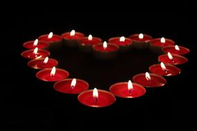 red Candles in Heart shape