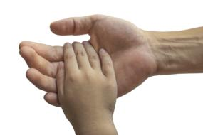 Hands of Adult man And Child boy together, Family