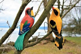 two colorful Birds, garden decoration on tree