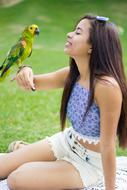 Girl and Parrot green grass