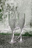 Beautiful wine Glasses with pink ribbons on Wedding