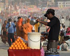 dealer of fresh orange juice on the street