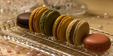 Macarons, colorful Cookies on glass tray