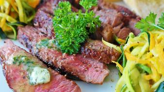 beef steak in marinade in herbs