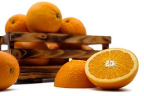 photo of ripe oranges in a wooden box