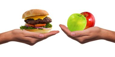 hands with healthy and unhealthy food