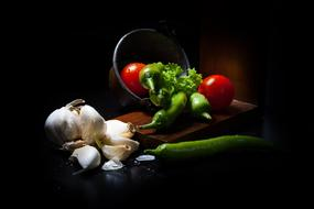 vegetables in the dark as a still life
