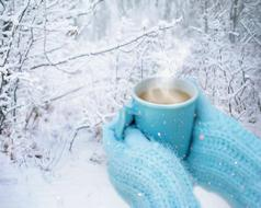 hot drink in the hands of a girl in mittens