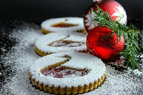 Christmas sponge cake with powdered sugar and colorful Christmas decorations