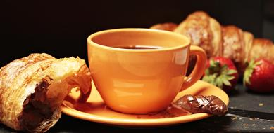 croissants with chocolate and a cup of coffee