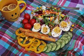 chopped vegetables, boiled eggs and vegetarian salad on a plate