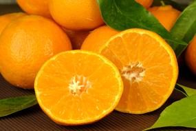 Beautiful tangerines with green leaves