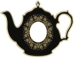 victorian teapot with empty oval frame