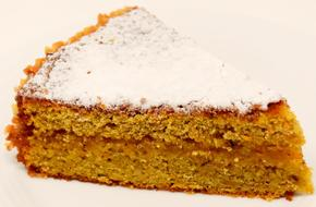 photo of a piece of carrot cake with icing sugar