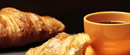 fresh tasty croissants and a cup of tea