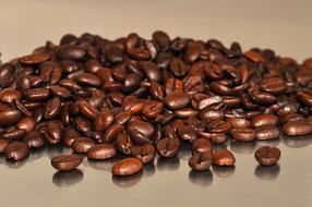 Coffee Beans on glossy surface