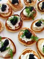 pancakes with black caviar and dill
