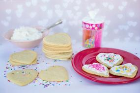 Decorating of heart cookies to valentine's day