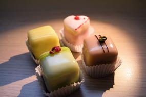 four marzipan sweets on the table