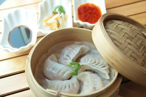 steamed chinese dumplings in a basket