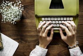 hands typewriter flowers
