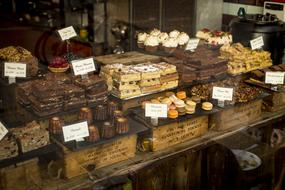delicious chocolate desserts on display in a pastry shop