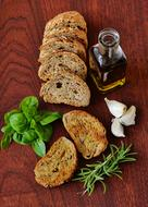 homemade bread, basil, rosemary and olive oil