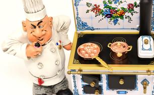 Star Chef at stove, vintage figurine