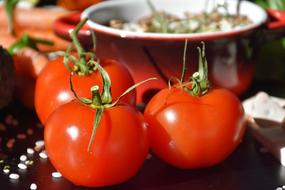 photo of red tomatoes on the background of the pan