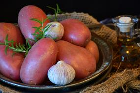 pink potatoes with garlic on a plate