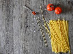 Cook pasta and tomatos