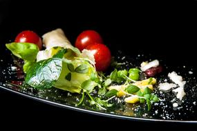 salad with tomatoes, Japanese spinach and parmesan